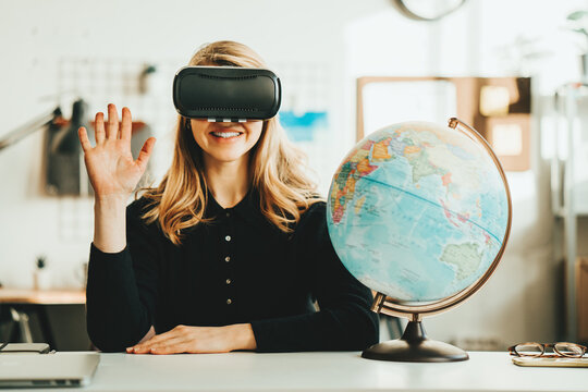 Pretty woman using vr headset and world map say virtual hello