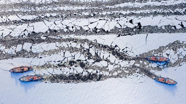 Four icebreakers crushes ice on Vistula river, Plock, Poland