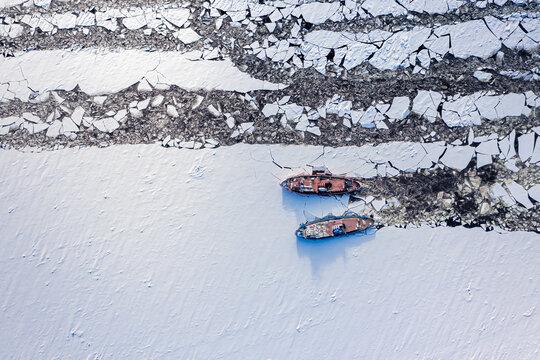 Aerial view of icebreakers on Vistula river crush ice