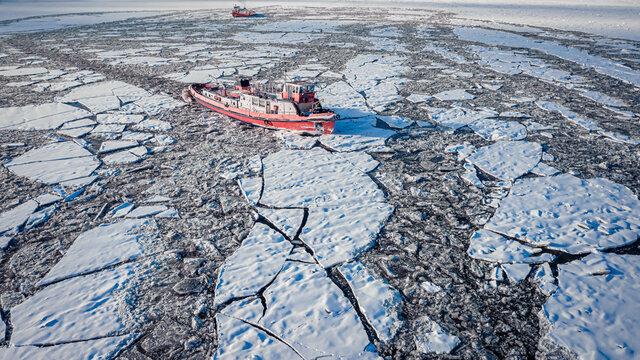 Icebreaker crushing ice on Vistula River, Poland
