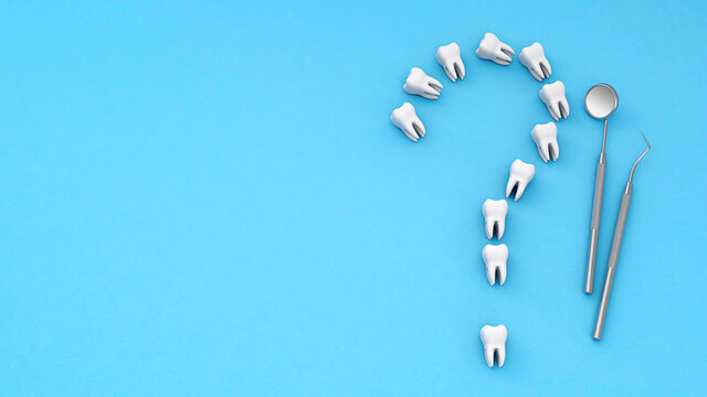 Teeth in the form of a question mark. Concept of how to care for and treat teeth. Tooth with a dental mirror and a hook on a blue background. Copy space for text. 3d render