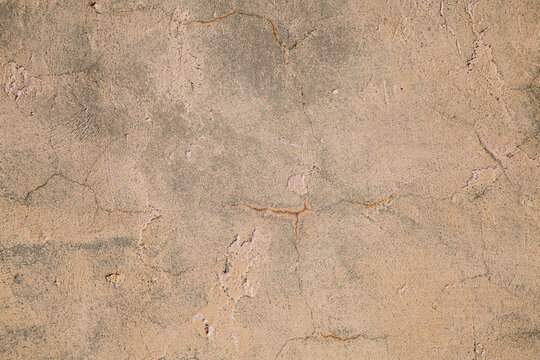 Old wall with scuffs and cracks, rough background
