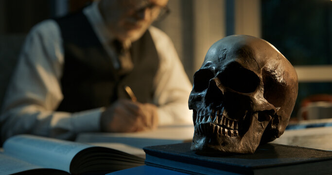 Academic professor studying a human skull