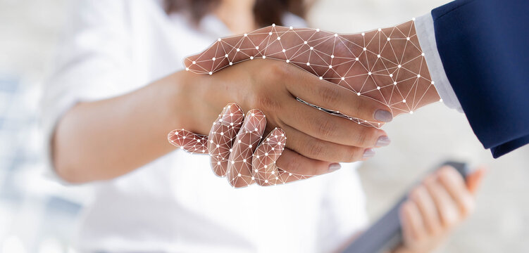 close up on businesswoman hand shaking with robotic AI hologram to confirm and dealing for business and technology innovation of RPA concept