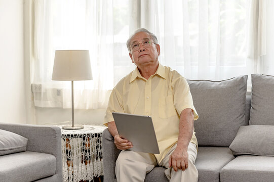 Lonely Asian Senior man was sick and at home alone. Retirement age lifestyle and mental health.