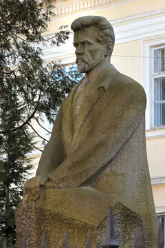 Lviv, Ukraine - March 10, 2018: Monument to Vasyl Stefanyk, a famous Ukrainian writer, in front of the National Scientific Library of Ukraine.