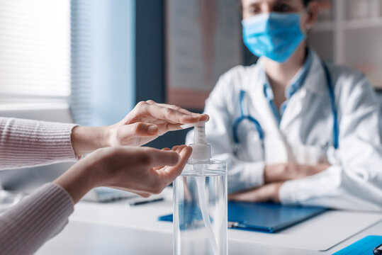 Patient sanitizing hands in the doctor's office
