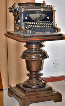 VANATORI, ROMANIA - May 02, 2016: an old typewriter on a wooden support at his Mihail Sadoveanu memorial house in Vanatori