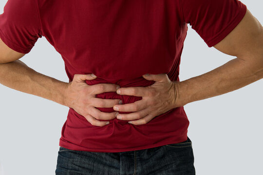 Man suffering from abdominal pain.