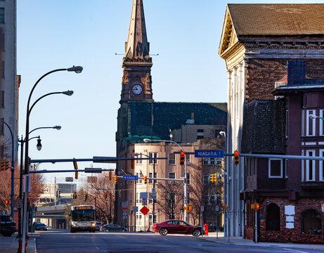 Bus on Franklin street near Saint Joseph Cathedral and Niagara sign