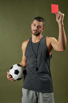 Handsome adorable football referee training football player in sport center