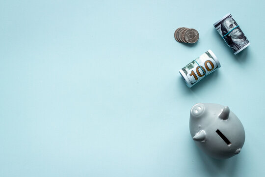 Saving money concept. Piggy bank with cash money and coins. Top view