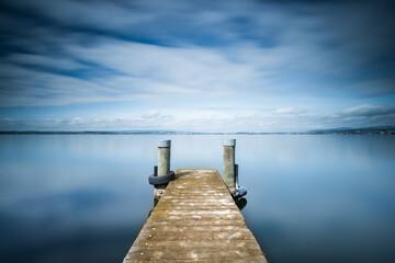 Lake Zug in Switzerland. Wooden pier.