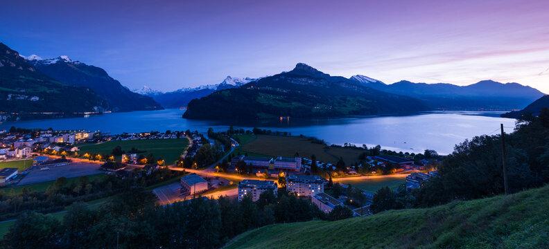 Night landscape. Panorama canton Schwyz, city of Brunnen. Lake Lucerne. Swiss Alps.
