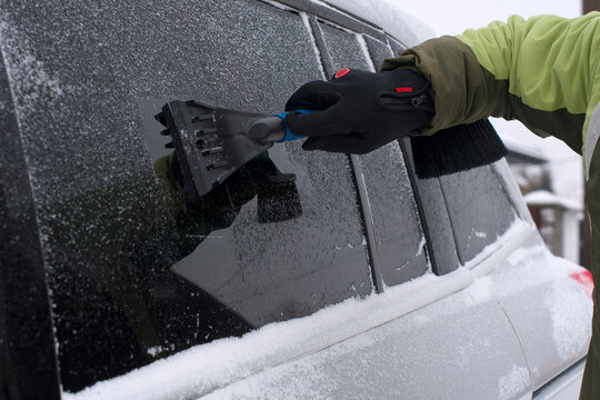 scraping ice from car