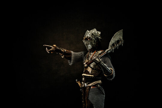 Medieval fighter in armor, pointing a finger at a direction, in profile, an ax on his shoulder