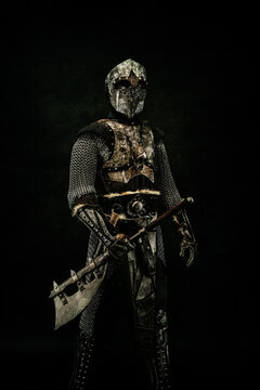 Medieval fighter in armor, in profile, an ax in his hand