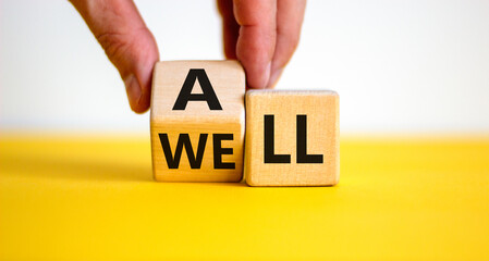 All is well symbol. Businessman turns cubes with words all well. Beautiful yellow table, white...