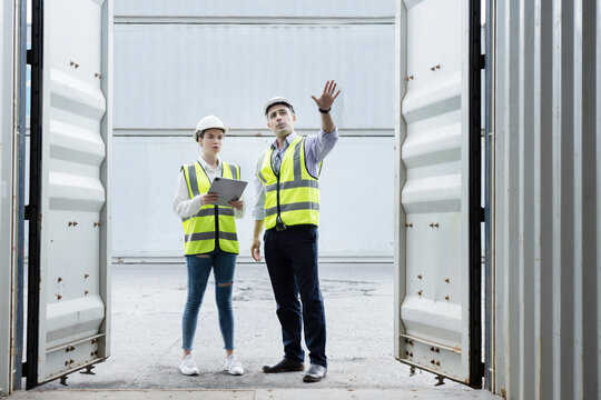 Caucasian Worker Open the Cargo Container Door th Check for Goods