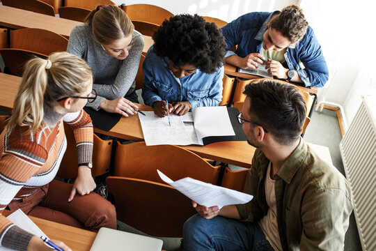 College students taking a test in a classroom.Educational concept.