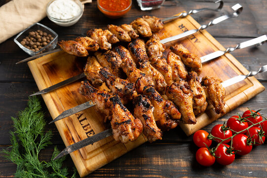 grilled or barbecue chicken wings skewer on board
