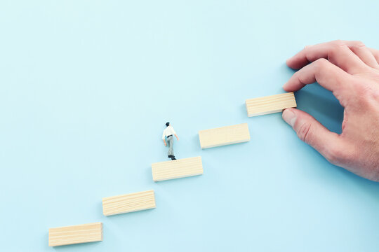 Business image of arranging wood blocks stacking as step stairs. Success and development concept