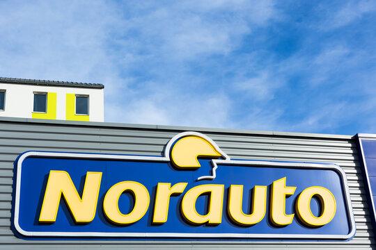 Norauto brand logo on bright blue sky background