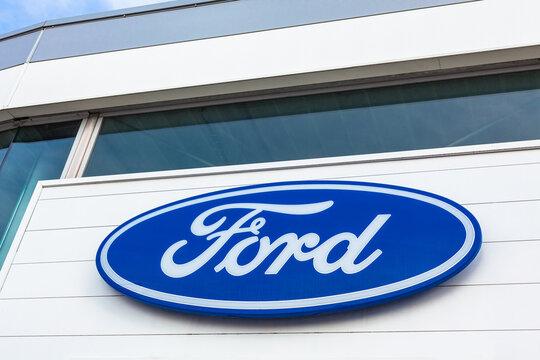 Ford brand logo on bright blue sky background