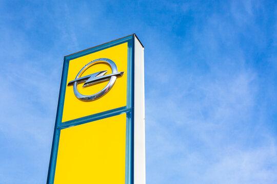 Opel brand logo on bright blue sky background