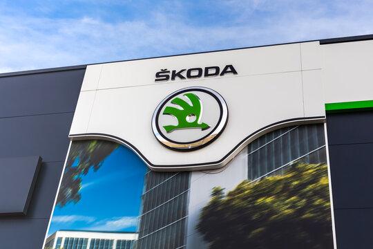 Skoda brand logo on bright blue sky background