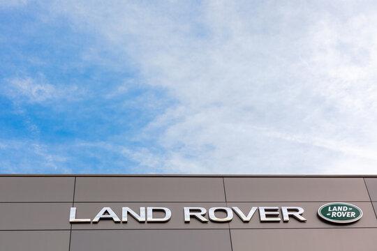 Land Rover brand logo, bright blue sky background