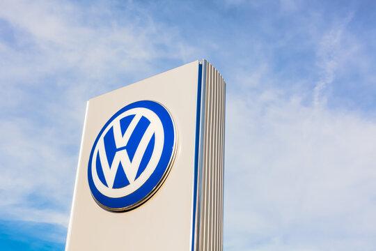 Volkswagen brand logo on blue sky background
