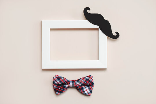 Happy Father's Day.White frame with bow tie and false mustache