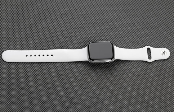 Rostov-on-Don, Russia - December 2019. Rostov-on-Don, Russia - December 2019. Apple Watch Series 5 Silver Aluminum Case with Sport Band White color. New smart watches from APPLE on a gray background.