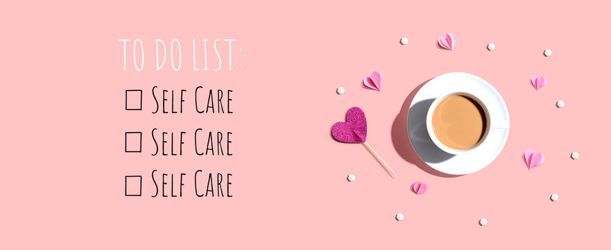 Self Care - To Do List with a cup of coffee and paper hearts - flat lay