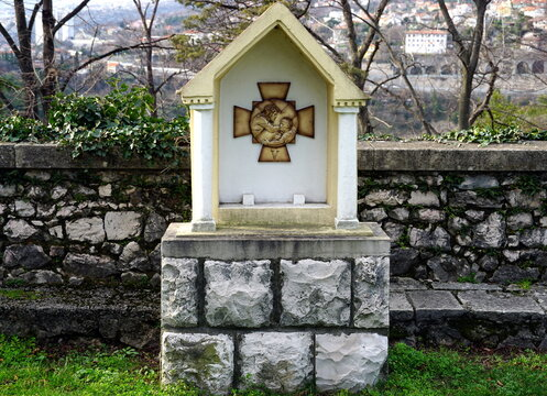 Stations of the Cross or Way of the Cross, 5th station, Simon of Cyrene is made to bear the cross