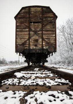 Abandoned vintage train wagon on railway in winter