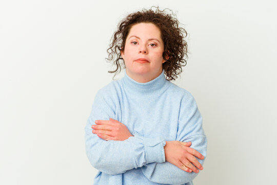 Woman with Down syndrome isolated frowning face in displeasure, keeps arms folded.