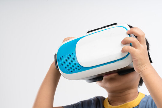 Asian boy watching virtual reality with VR headset