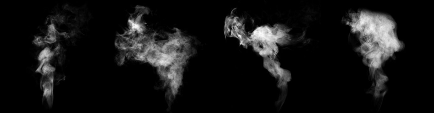 Set of streams of steam isolated on black background