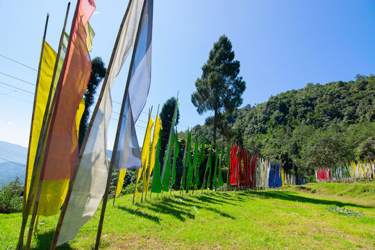 Buddist prayer flages for the departed souls, waving at Rinchenpong Monastery, Sikkim, India