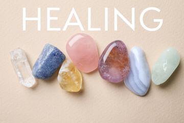 Beautiful gemstones on beige background, top view. Healing crystals