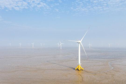 wind farm on coastal mudflat wetland