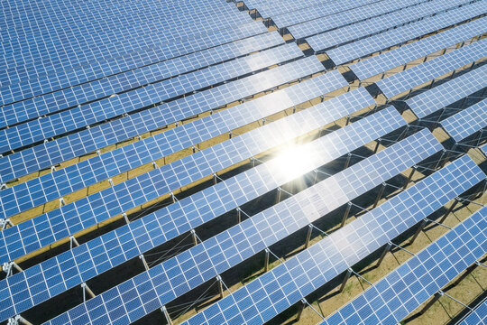 blue photovoltaic panels in sunlight