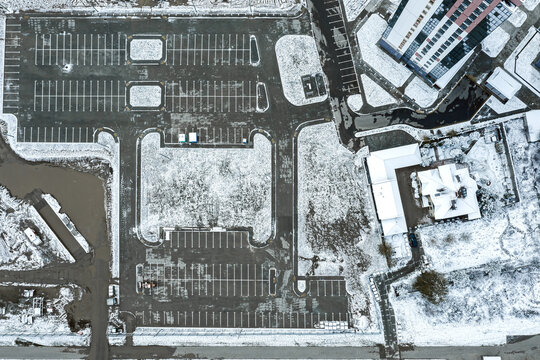 construction of a new parking lot in the residential district. aerial view in winter