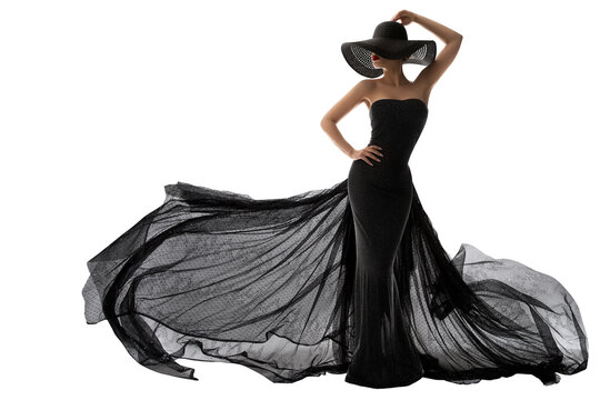 Woman Black Dress Fashion. Elegant Lady in Hat. Model Silhouette in Evening Long Black Gown Fluttering on Wind. Isolated White