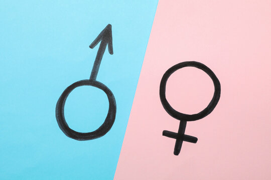 Male and female symbols on two tone background