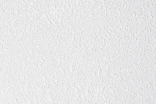 Rough grainy white paint structure background. Grungy light grey texture. Rugged urban pattern for cool abstract effect. Granular grunge surface material. Cracked gray concrete cement wall.