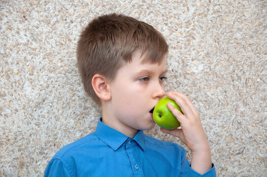 Child boy with apple, healthy food.