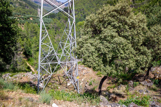 High-voltage electrical towers to transport energy through the mountains to the city.